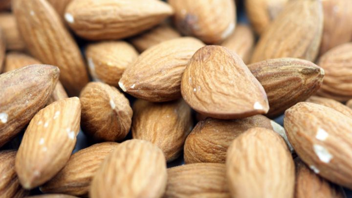 close-up image of almonds with skin intact